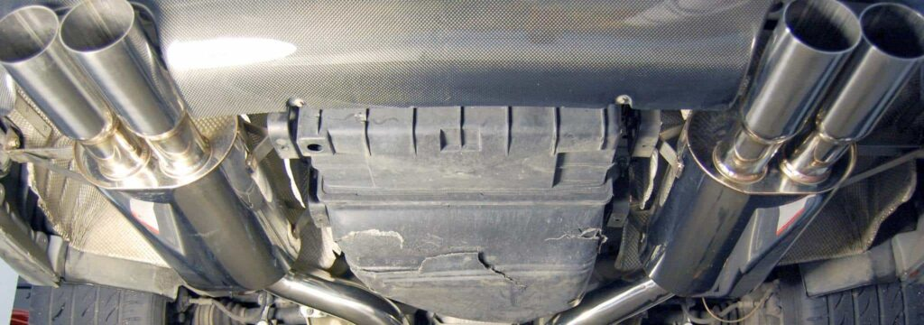 Twin Double-Outlet mufflers on a car