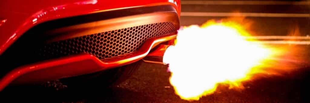 Muffler on a red car shooting flames