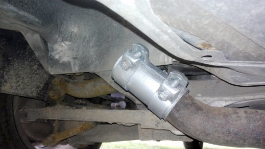 A new exhaust clamp connected to an exhaust pipe.